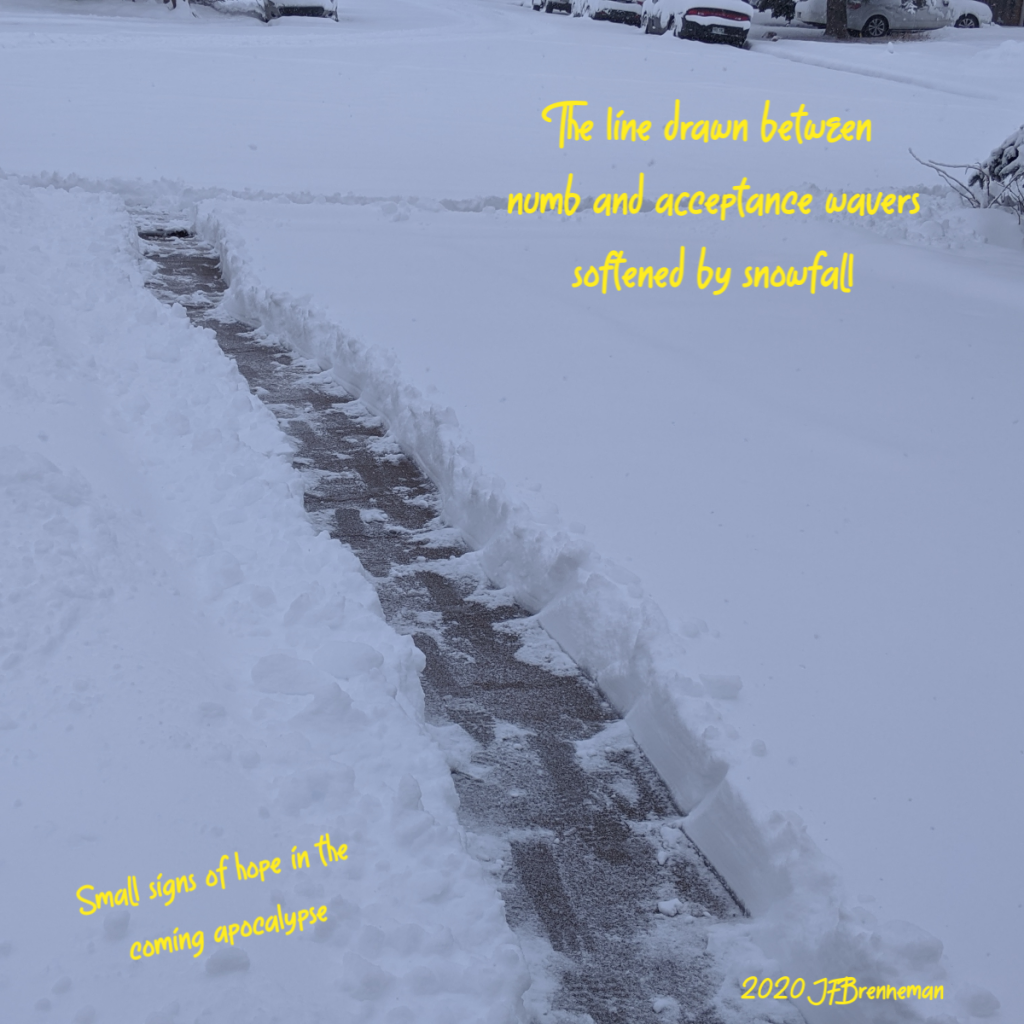 narrow path shoveled through deep snow; text overlaid on image