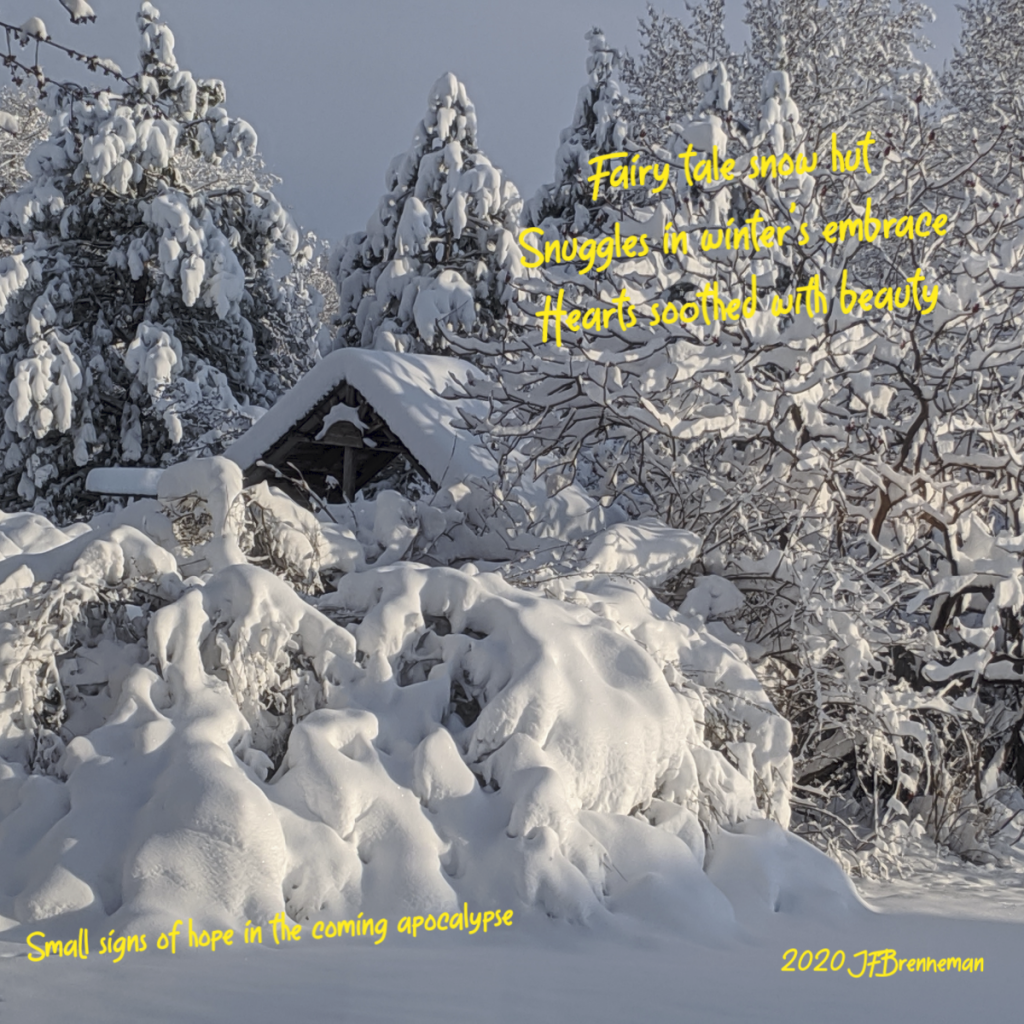 heavy spring snowfall covering trees and shrubbery, surrounding the upper roof-line of a small hut, also snow covered; text overlaid on image.