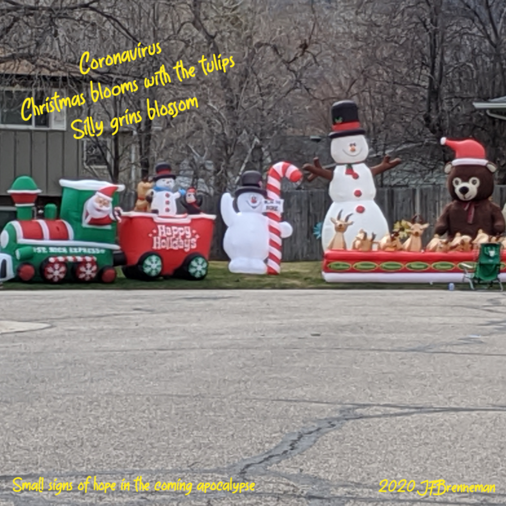 large display of inflatable Christmas characters on front lawn 4 months after Christmas