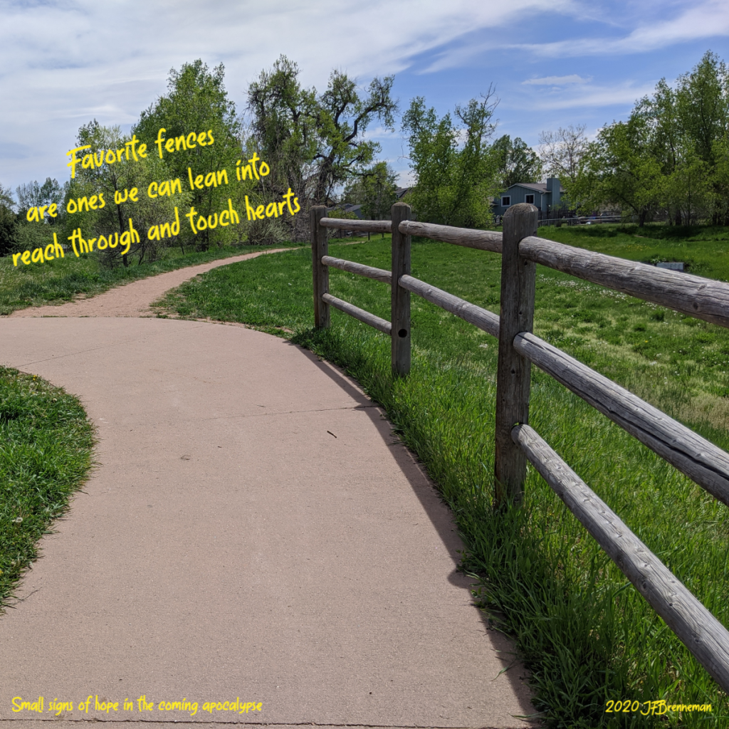 wooden fence alongside paved trail in meadow; text overlaid on image