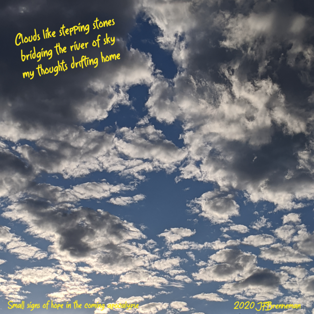 clouds scattered in blue sky; text overlaid on image