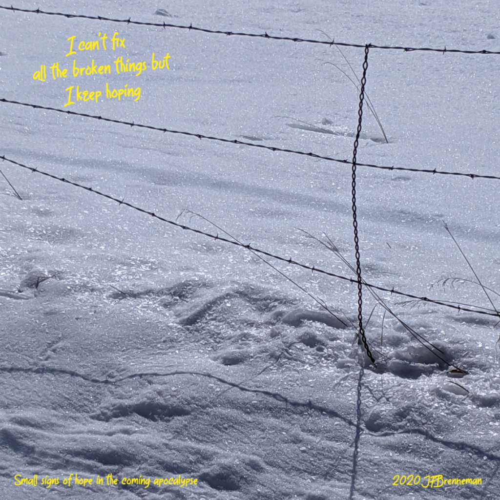 barbed wire fence and snow covered field; text overlaid on image