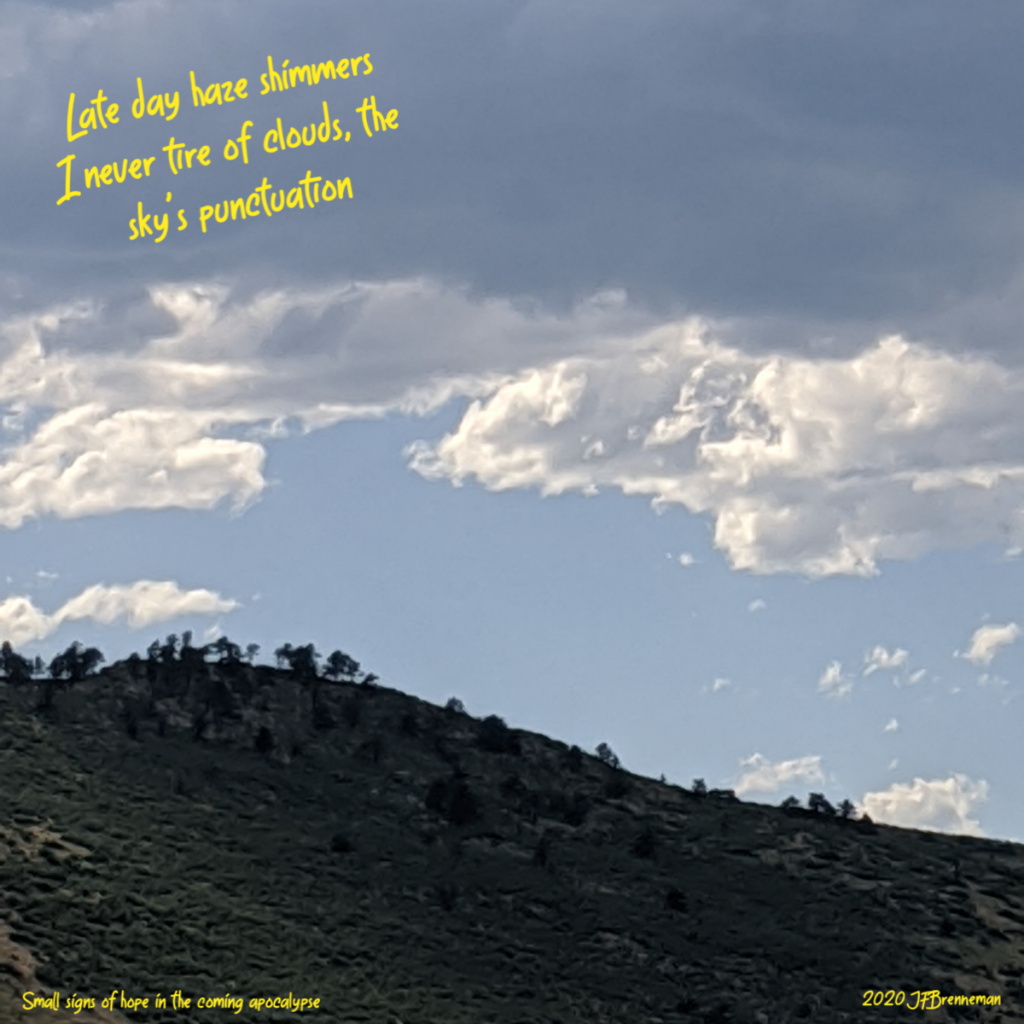 Late day clouds massing above ridgeline; text overlaid on image
