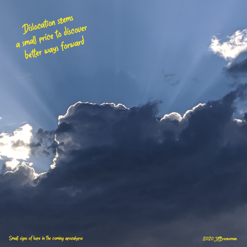 sunrays radiating out above dark backlit clouds; text overlaid on image