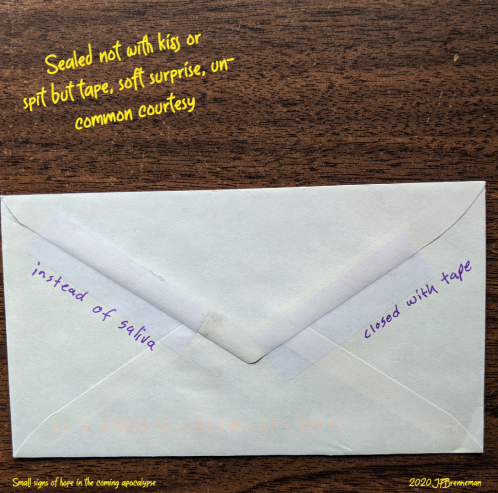 back of envelope, flap sealed with clear tape, text overlaid on image