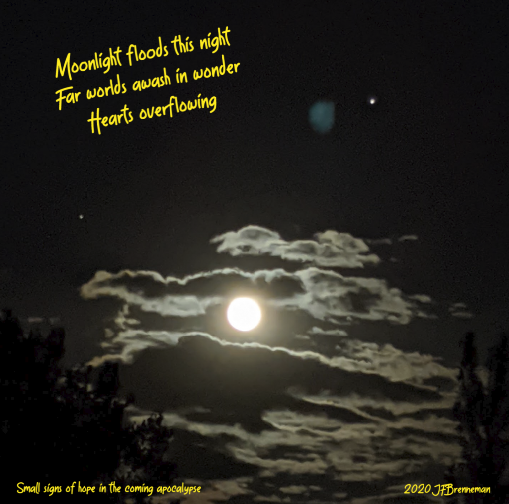 Full moon, moonlit clouds, Jupiter, and Saturn; text overlaid on image