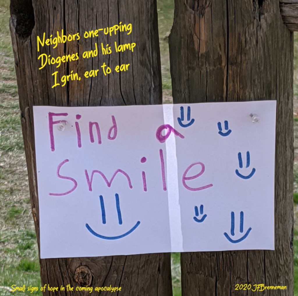 "Handlettered sign, ""Find a smile,"" tacked to weathered wooden fence picket; text overlaid on image"