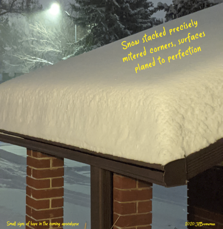 Fresh, deep, undisturbed snow on roof; text overlaid on image