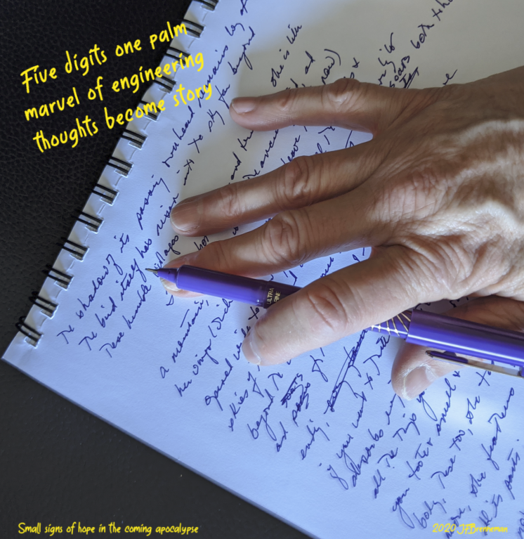 Author's hand holding pen, resting on paper filled with longhand draft; text overlaid on image