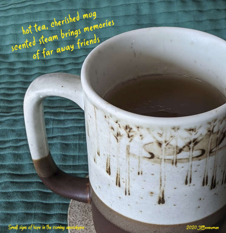 small ceramic mug filled with tea; text overlaid on image