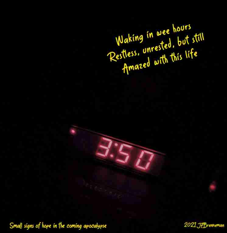 Glowing red numbers of digital alarm clock: 3:50 a.m.; text overlaid on image