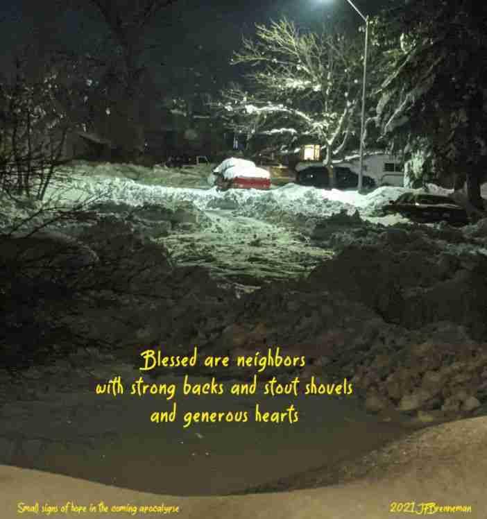 Unplowed city street with hand-dug path through deep snow ; text overlaid on image